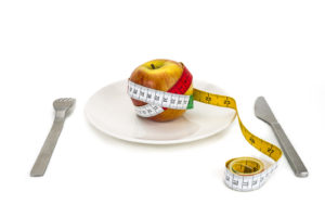 Low carb diet food is apple Fork and knife